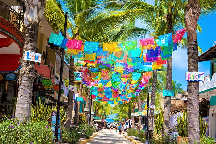 Sayulita, Mexico-October 6, 2017: Sayulita is a village on Mexico's Pacific coast backed by the Sierra Madre Occidental mountains. It is known for its' beaches with strong surf. Galleries sell artworks by Huichol indigenous people and local homemade wares. Shot taken with Canon 5D Mark lV.