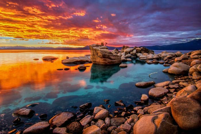 Candy colored skies light up the shoreline at Lake Tahoe, Nevada.